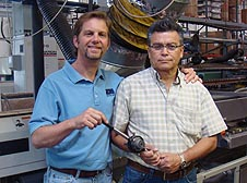 Peter Neville, President, B&H Tool  Company and Silverio Pelayo,  Production Manager, SMAC (Carlsbad,  CA), are shown with an in-line  spider head and the new tip assembly wrench. This time-saving new tool gives operators a solid, positive grip, allowing quick and efficient tip removal without risking damage to the flats.